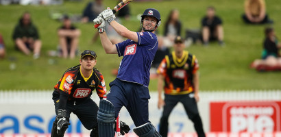 Auckland Ace's Colin Munro hits a six during the Georgie Pie Super Smash T20 cricket Final - Firebirds v Aces at Seddon Park, Hamilton, New Zealand on Sunday 7 December 2014.  Photo: Bruce Lim / www.photosport.co.nz